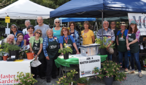 Extension Master Gardener Volunteers pose together for a picture after setting up the 2019 Plant Sale at Duke Gardens