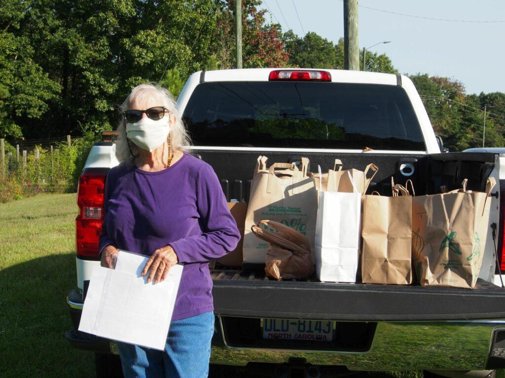 Volunteer with supplies in truck